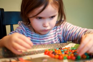 Child counting jelly beans