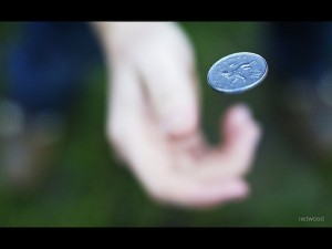 Photo of a coin toss.