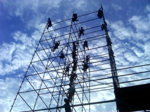 photo of people standing at junctures of steel scaffold