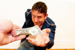 close up of dollar in hand with skeevy looking guy reaching out for it