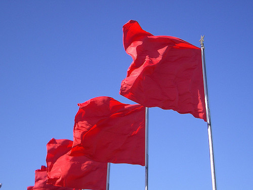 row of red flags fluttering
