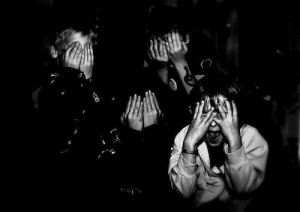 children covering their faces with their hands, as if in horror