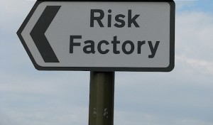 """road sign pointing to a """"risk factory"""""""