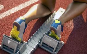 runner's feet in starting block