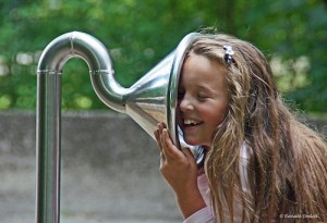 girl listening to ear trumpet