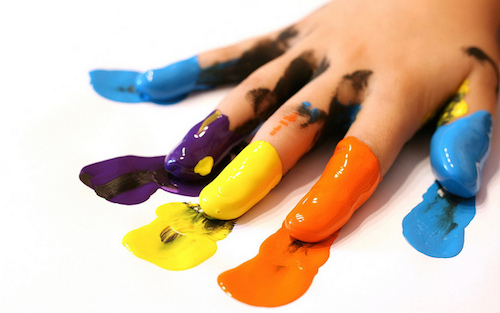 fingers dipped in different colours of paint
