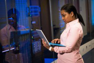 black woman at computer server