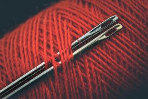 needles on red thread