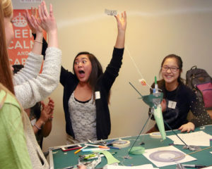 girls cheer when their experiment succeeds at Science Rendezvous event