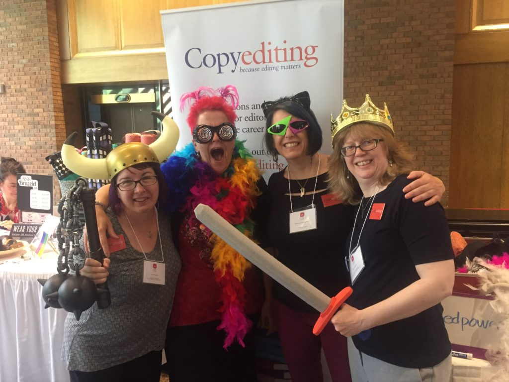 Copyediting crew dressed as superheroes at editors17: Laura Poole, Amy Schneider, Adrienne Montgomerie, Erin Brenner