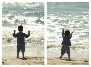 kid throwing sand in a lake
