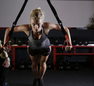 woman exercising with intense look on her face