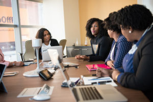 business women meeting with laptops at a boardroom table
