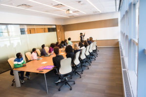 meeting room showing mostly women and mostly people of color
