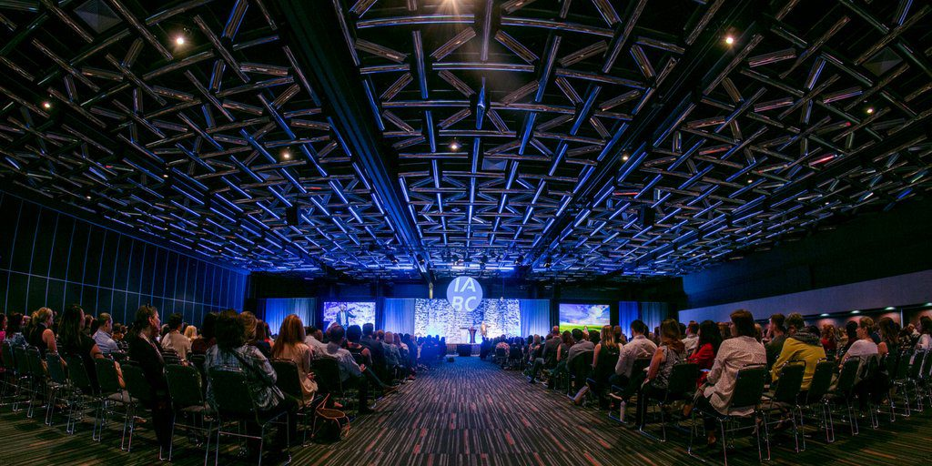 view from the back of the ballroom, looking at Seth Godin on the conference main stage through 1300 delegates in Montreal, Canada, in June 2018.