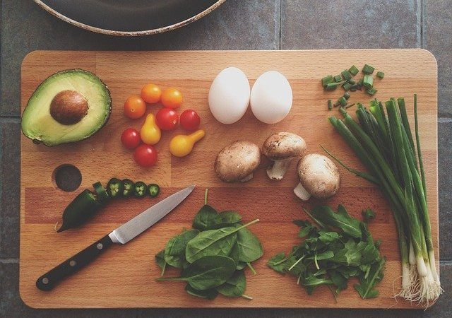 chopping board with foods grouped